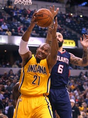 Indiana Pacer David West grabs one of his four defensive rebounds against the Atlanta Hawks and Pero Antic during the Pacers' 108-92 loss to the Hawks at Bankers Life Fieldhouse in Indianapolis on Monday, Dec. 8, 2014.
