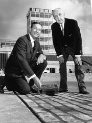 Speedway president Tony Hulman Jr. (left) and Ray Harroun, the winner of the first 500, placed a gold alloy brick on the start-finish line at the Indianapolis Motor Speedway track on Nov. 6, 1961.