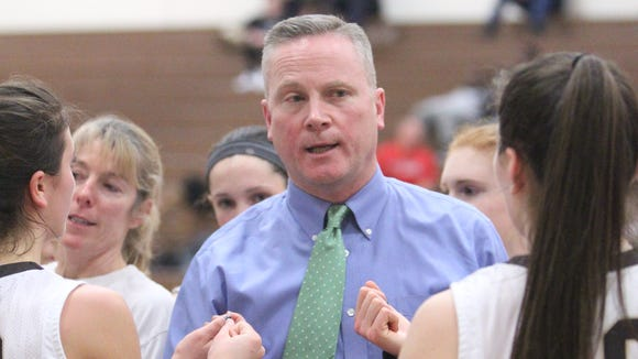 Clarkstown South girls basketball head coach Brian Metcalf talks to his team during a game on Jan. 27, 2016.