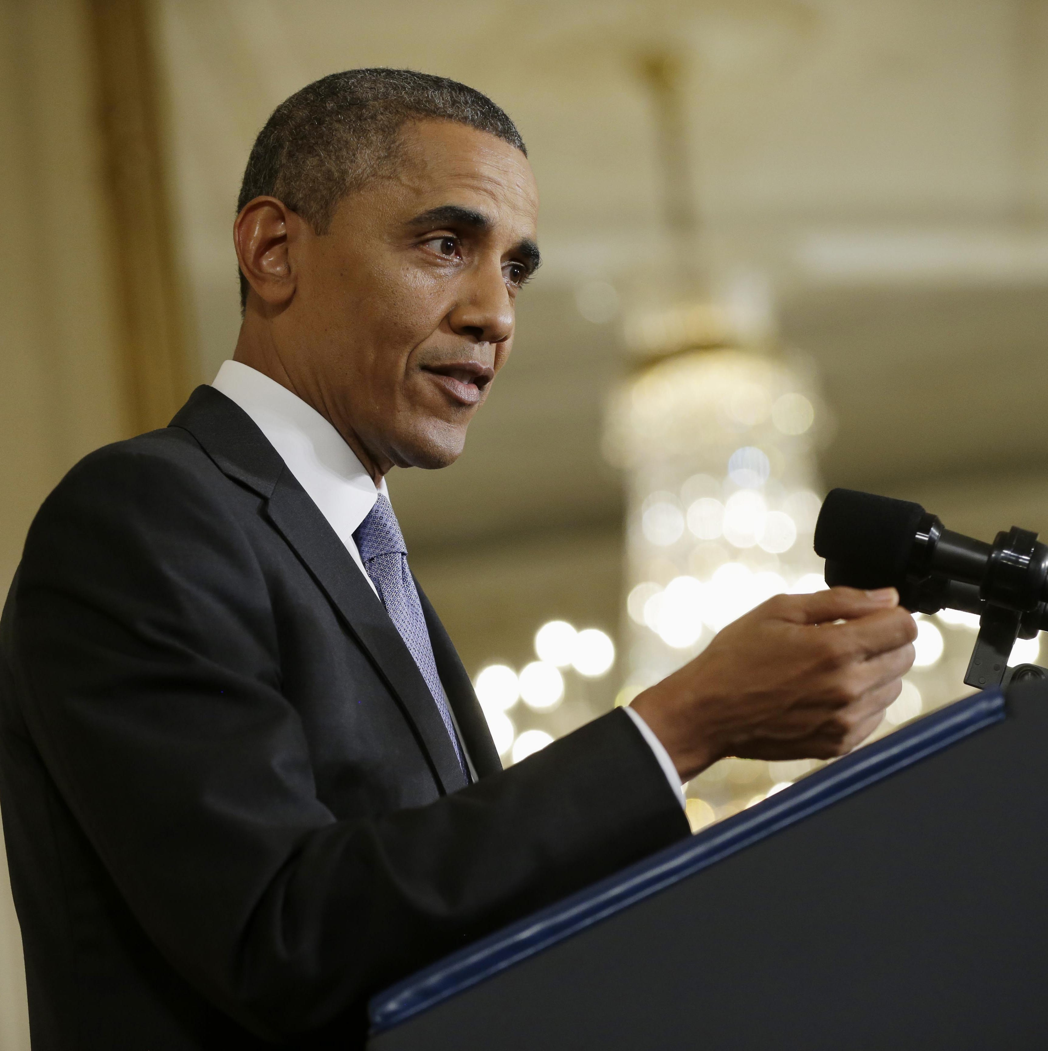 President Barack Obama gestures during his news conference in the East Room of the White House in Washington, Friday. The president said he'll work with Congress to change the oversight of some of the National Security Agency's controversial surveillance programs and name a new panel of outside experts to review technologies.