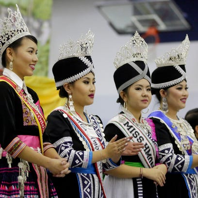 From left: Miss Hmong Wisconsin Mai Yer, Miss Hmong Wisconsin Teen Chee Dra Lee, Miss Hmong America Mai Moua Lee and Miss Hmong International Jar Xiong appear on stage during the Hmong New Year Saturday November 28, 2015 Sheboygan North.