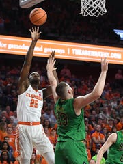 Clemson forward Aamir Simms (25) scores over Notre Dame forward Martinas Geben (23) during the 2nd half on Saturday, January 20,  2018 at Clemson's Littlejohn Coliseum.