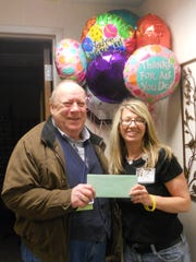 Joe Stein receives a Marshfield Area Chamber of Commerce and Industry gift certificate from Volunteer Manager Keresa Kilty during National Volunteer Appreciation Month activities in April at Ministry Saint Joseph's Hospital in Marshfield.