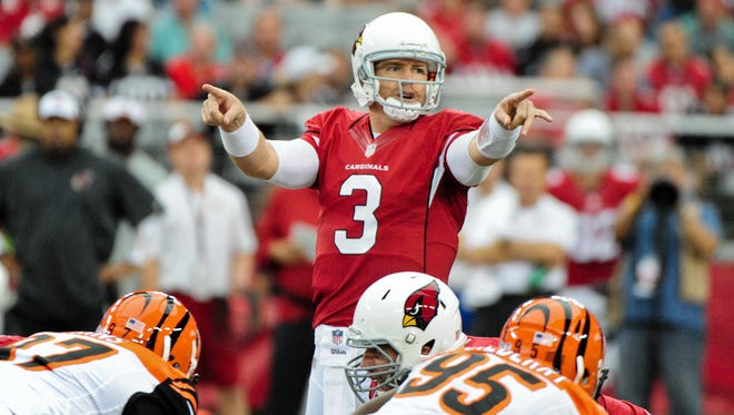 Aug. 24, 2014; Glendale; Arizona Cardinals quarterback Carson Palmer signals to teammates prior to the snap during the first half of a preseason game against the Cincinnati Bengals at University of Phoenix Stadium.
