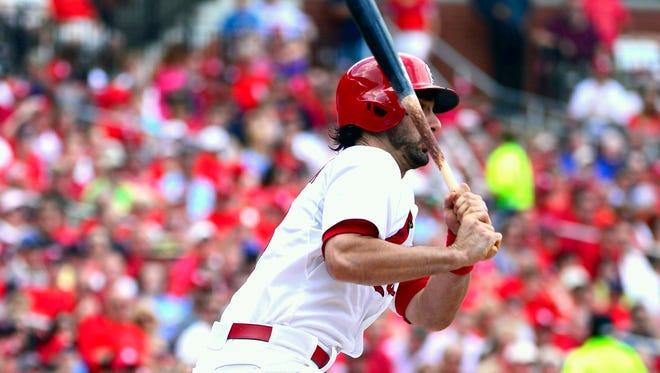 Matt Carpenter hits an RBI groundout against the Nationals in the third inning.