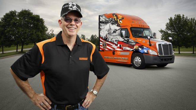 Jay Hull, a U.S. Army veteran from Green Bay, is the driver behind the wheel of Schneider's 2015 Ride of Pride truck from Freightliner Trucks.