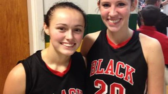 North Buncombe's Haley Higgins, left, and Kelsi McHone.