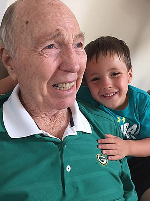 Bart Starr and his great-grandson Bryan Jackson celebrate Starr's 83rd birthday in early January 2017.