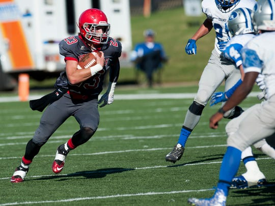 Abbeville Christian's Griffin Fenn (23) carries against Chambers Academy at the AISA State Championships in Troy, Ala. on Friday November 20, 2015.
