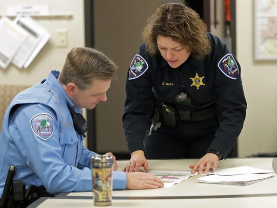 Lt. Kelly Gady works earlier this month with lead CSO/Humane