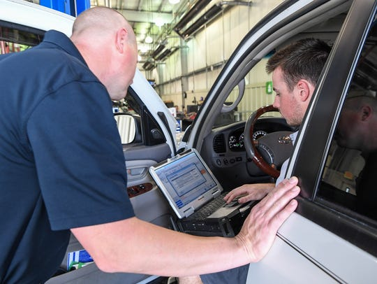 Michael Muldoon, left, Toyota of Easley Service Manager,