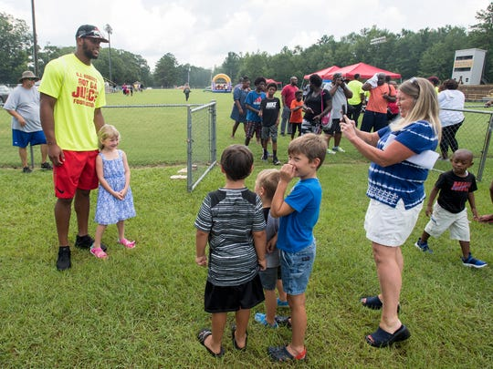 O J Howard poses for photos as he holds an event giving out backpacks to children at the Autauga Academy campus in Prattville, Ala. on Sunday July 9, 2017.