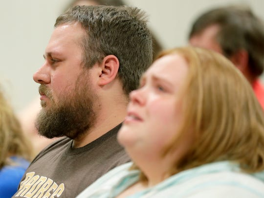 Greg Gussert, the father of Brianna Gussert, listens in court Monday as his ex-wife, Nicole L. Gussert, 37, of Appleton, is charged with causing the 13-year-old girl's death by neglect.
