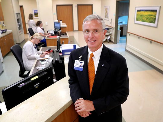 Gordon Ferguson, CEO of Saint Thomas Rutherford Hospital, stands at the main nurses station in the newly added Clinical Decision Unit on Thursday, Aug. 2, 2018.
