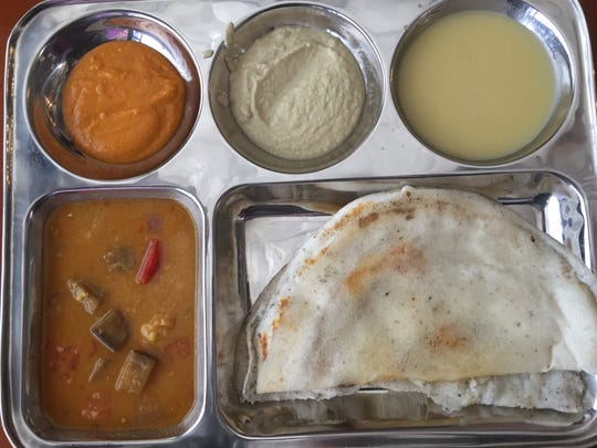 The dosa platter at Maya's South Indian Cuisine features plain and potato-onion versions of the rice and lentil crêpe.