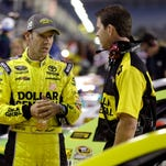 Matt Kenseth, left, talks to a crew member before qualifying for the Bank of America race at Charlotte Motor Speedway in Concord, N.C., on Thursday.