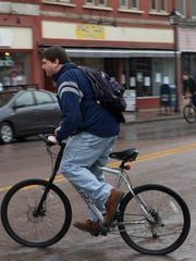 Papineau rides his bike home after a Circles of Support