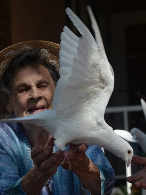Marta Nelson, a resident of The Gables of Ojai, releases a dove at last year's International Peace Day celebration in Ojai. A dove release is scheduled again this year, along with a drum and bell chant and meditation.