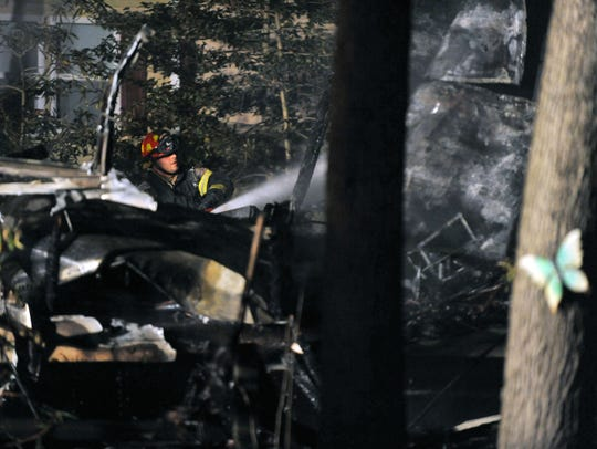 A firefighter from East Vineland (left) joined multiple