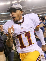 Washington Redskins receiver DeSean Jackson yells as he runs off the field after his team's division-clinching 38-24 victory over the Philadelphia Eagles.