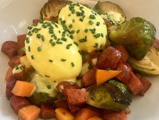 Sweet potato and andouille hash, with poached eggs,