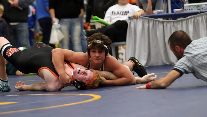South Kitsap's Sebastian Robles wrestles Washougal's Tanner Lees during their 152-pound championship bout at the HammerHead wrestling tournament on Saturday. Robles won his fourth HammerHead individual with a 13-2 victory and South Kitsap repeated as team champions.