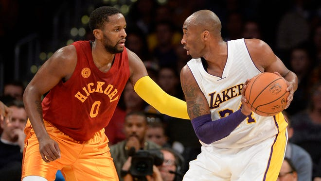 Los Angeles Lakers forward Kobe Bryant (24) controls the ball against Indiana Pacers forward C.J. Miles (0) in the first half at Staples Center.