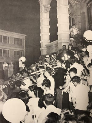 A brass band plays patriotic music at Norwich City Hall on Aug. 15, 1945, to celebrate the end of World War II.