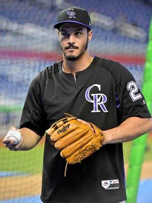 Colorado Rockies third baseman Nolan Arenado has a league-leading 100 RBIs.