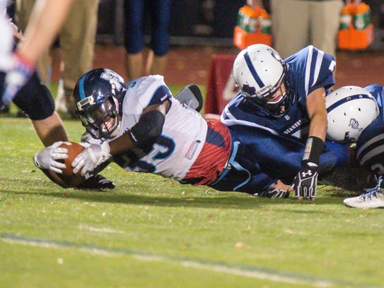 Mt. Mansfield's Jehric Hackney stretches out for extra