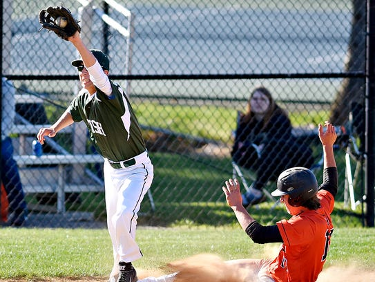 York Catholic's Will Catterall, left, cathches the