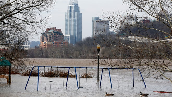 The playground at Bellevue Beach Park in Bellevue, Kentucky is surrounded by floodwaters from the Ohio River Tuesday February 20, 2018. The National Weather Service has extended  a flood warning for the river until 1 a.m. Saturday. More rain is expected Tuesday night into Wednesday morning when the river is expected to crest at 56.1 feet and remain above flood stage until Friday.