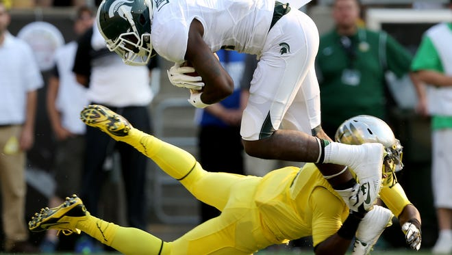 Tony Lippett and Michigan State dropped to No. 13 in the Associated Press and USA Today Amway coaches polls this week.