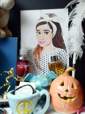 A drawing of pop singer Ariana Grande sits in Holly McCoy's room. Grande is McCoy's favorite subject.