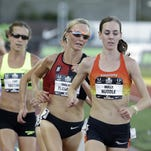 Molly Huddle, right, gets a hug from Shalane Flanagan after winning the women's 10,000 meters Thursday.