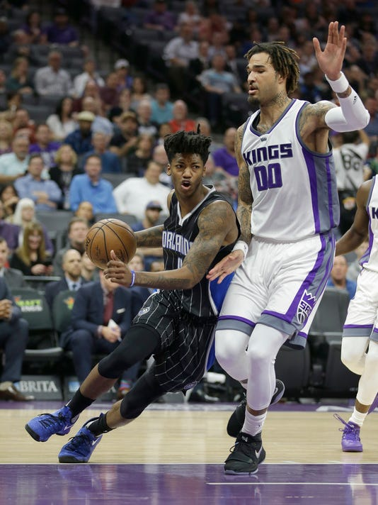 Orlando Magic guard Elfrid Payton, left, drives against Sacramento Kings center Willie Cauley-Stein during the first half of an NBA basketball game Monday, March 13, 2017, in Sacramento, Calif. (AP Photo/Rich Pedroncelli)