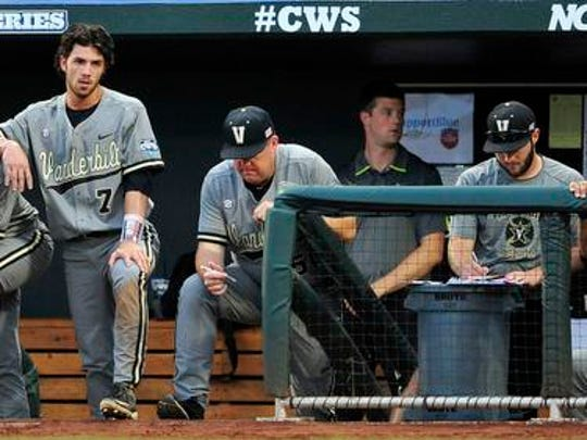 Vanderbilt players including Rhett Wiseman, left, Dansby Swanson (7), Zander Wiel (43) watch from the dugout against Virginia during the 4th inning in the Game 2 of the College World Series finals at TD Ameritrade Park, Tuesday, June 23, 2015, in Omaha, Neb.