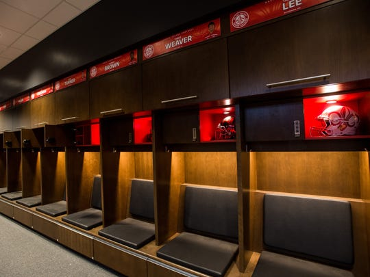 Football players' lockers are pictured UL's athletic performance center, which opened last year.