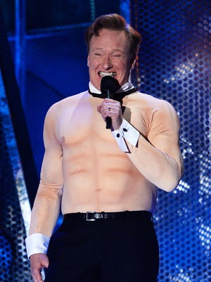 Conan O'Brien shows off his fake physique at the 2014 MTV Movie Awards at Nokia Theatre L.A. Live on April 13 in Los Angeles.
