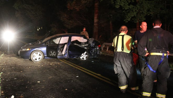 Bedford Hills firefighters and Bedford police finish up their work at the scene of a single car accident that injured 6 people on Springhurst Road in Bedford Oct. 1, 2014.