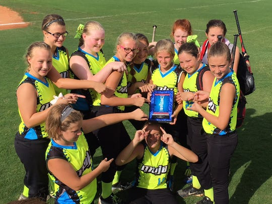 Team Mojo is shown with the sportsmanship award they received after playing in Orlando, Florida. The team qualified for the USSSA Fast Pitch World Series at Disney's ESPN Wide World of Sports Complex in the 12U age group.