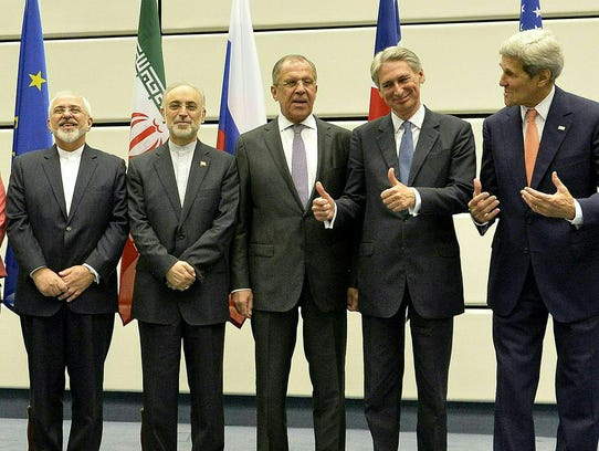 Iran's Foreign Minister Javad Zarif, far left, laughs