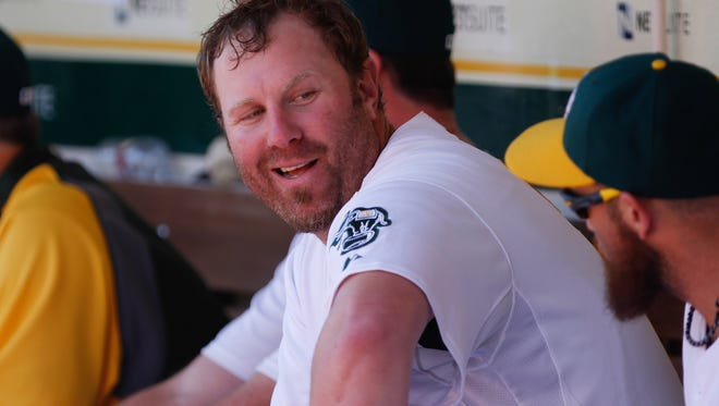 Oakland Athletics designated hitter Adam Dunn looks on from the dugout against the Seattle Mariners during the fourth inning at O.co Coliseum.