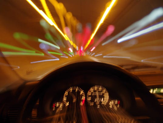 Blurred motion car drivers view traveling through tunnel