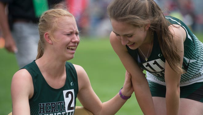 Leeann Wagner of Heritage Christian School cries with her teammate, Tessa Lesondak after winning a state title in the 1A 800-meter race during the CHSAA State Track and Field Championships at JeffCo Stadium in Lakewood on Friday.