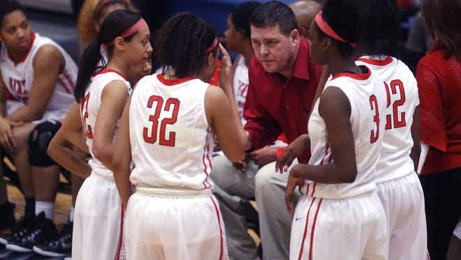 Pike Red Devils Girls Basketball Coach Bob Anglea gives instructions to his team, which trailed Lawrence North throughout their 59-50 loss to the Wildcats in the Girls Class 4A Regional final at Decature Central on Saturday, Feb. 21, 2015.