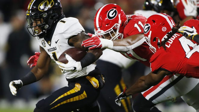 Missouri running back Tyler Badie (1) is taken down Georgia linebacker Jermaine Johnson (11) and Georgia running back James Cook (4) during a kickoff return in the first half of a NCAA football game between Georgia and Missouri in Athens, Ga., on Saturday, Nov. 9, 2019.