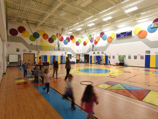 Preschoolers streak around the gymnasium at West Muskingum Elementary School recently.