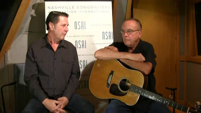 """Tony Arata, right, talks to Bart Herbison about writing """"I'm Holding My Own."""""""