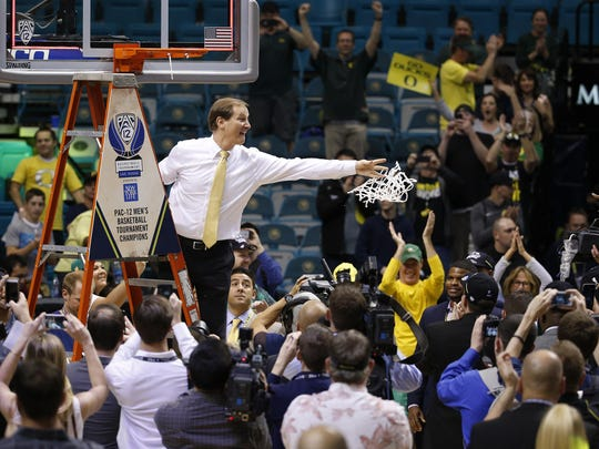 Oregon coach Dana Altman tosses the net while the team celebrates after defeating Utah in an NCAA college basketball game in the championship of the Pac-12 men's tournament Saturday, March 12, 2016, in Las Vegas. Oregon won 88-57. (AP Photo/John Locher)